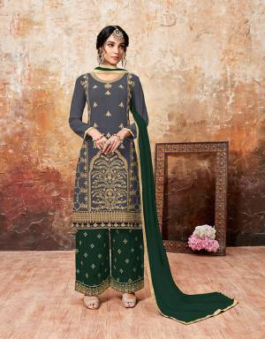 Grab This Beautiful Designer Plazzo Suit With Lovely Color Pallete. Iits top Is In Dark Grey Color Paired With Dark Green Colored Bottom And Dupatta. Its Top And Bottom Are Georgette Based Paired With Chiffon Dupatta. Buy This Semi-Stitched Suit Now.