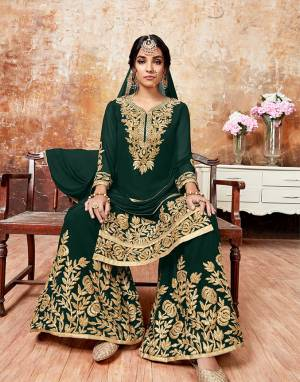 Here Is A Beautiful Designer Sharara Suit For The Upcoming Festive And wedding Season. Its Top And Bottom Are Georgette Based Paired With Chiffon Dupatta. It Is Beautified With Gota Ribbon Work All Over.