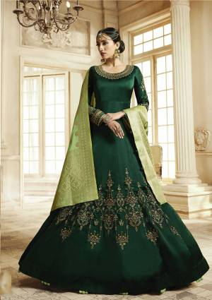 Here Is A Beautiful Heavy deisgner Floor Lengtj Suit In Dark Green Color Paired With Light Green Colored Dupatta. Its Top Is Fabricated On Satin Georgette Paired With Santoon Bottom And Banarasi Art Silk Dupatta. It Is Beautified With Elegant Embroidery Work. Buy This Semi-Stitched Suit Now.