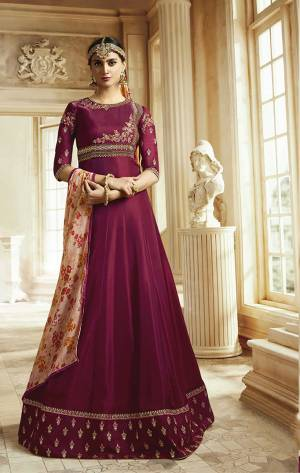 Shine Bright Wearing This Designer Floor Length Suit In Dark Magenta Pink Color Paired With Contrasting Peach Colored Dupatta. Its Top Is Fabricated On Soft Silk Paired With Santoon Bottom And Georgette Dupatta. Its Pretty Color Combination Will earn You Lots Of Compliments From Onlookers.