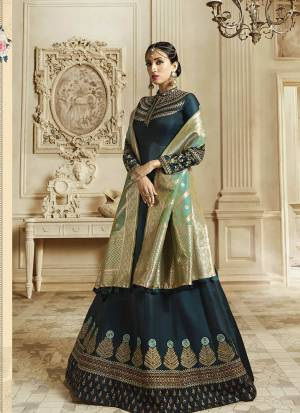 You Will Definitely Earn Lots Of Compliments Wearing This Designer Floor Length Suit In Prussian Blue Color Paired With Contrasting Sea Green Colored Dupatta. Its Top Is Fabricated On Soft Silk Paired With Santoon Bottom And Banarasi Art Silk Dupatta. All Its Fabric Ensures Superb Comfort All Day Long.