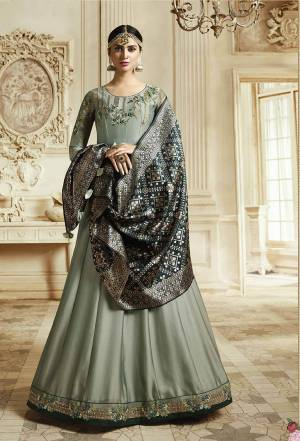 Flaunt Your Rich And Elegant Taste Wearing This Designer Floor Length Suit In Aqua Blue Color Paired With Contrasting Dark Teal Colored Dupatta. Its Top IS Georgette Based Paired With Santoon Bottom And Banarasi Art Silk Dupatta. Buy Now.