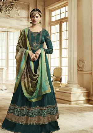 Add This New Shade To Your Wardrobe With This Designer Floor Length Suit In Teal Green Color Paired With Multi Colored Dupatta. Its Top Is Fabricated On Soft Silk Paired With Santoon Bottom And Georgette Dupatta. This Suit Is Light In Weight And Easy To Carry All Day Long.
