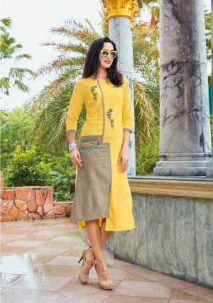 Grab This Beautiful Designer Readymade Kurti In Yellow And Grey Color Fabricated On Linen. It Has Pretty Thread Embroidery Giving It An Attractive Look.