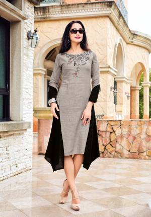 Rich And Elegant Color pallete Is Here With This Designer Readymade Kurti In Grey And Black Color Which Is Fabricated On Rich Linen Fabric. It Is Light In Weight And Easy To Carry All Day Long.