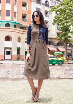 Enhance Your Personality Wearing This Designer Readymade Kurti In Grey And Navy Blue Color Fabricated On Linen. It Has Pretty Thread Work And Tassels over the Yoke. Buy Now.