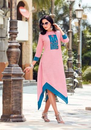 Look Pretty In This Readymade Kurti In Pink And Blue Color Fabricated On Linen Beautified With Thread Work. It Is Available In All Regular Sizes. Buy Now.