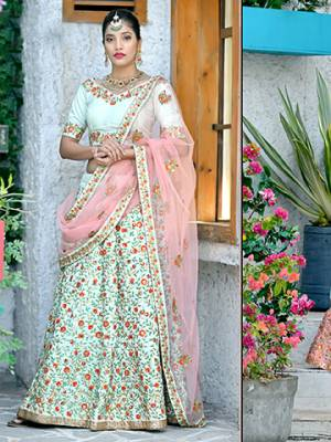 Here Is A Very Pretty And Subtle Color Pallete With This Heavy Designer Lehenga Choli In Pastel Green Color Paired With Contrasting Baby Pink Colored Dupatta. This Lehenga Choli Silk Based Paired With Net Fabricated Dupatta. It Is Beautufied With Contrasting Embroidery Giving It An Attractive Look.