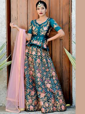 Get Ready For The Upcoming Wedding Season With This Heavy Designer Lehenga Choli In Blue Color Paired With Contrasting Baby Pink Colored Dupatta. This Lehenga Choli Is Fabricated On Satin Silk Paired With Net Fabricated Dupatta.