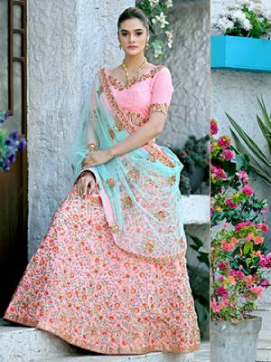 Look Pretty In This Heavy Designer Lehenga Choli In Pink Color Paired With Contrasting Blue Colored Dupatta. This Lehenga Choli Is Rich Silk Based Paired With Net Fabricated Dupatta. This Lehenga Choli Has Pretty Shades In Fabric And Embroidery Which Earn You Lots Of Compliments From Onlookers.