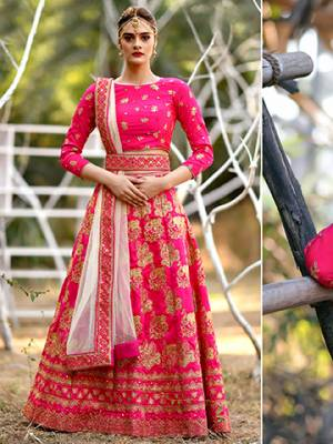 Bright And Visually Appealing Color Is Here With This Heavy Designer Lehenga Choli In Dark Pink Color Paired With Pastel Pink Colored Dupatta. Its Blouse And Lehenga Are Fabricated On Art Silk Paired With Net Fabricated Dupatta. It Is Beautified With Heavy Jari Embroidery All Over It.