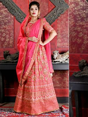 Bright And Visually Appealing Color Is Here With This Heavy Designer Lehenga Choli In Dark Pink Color. Its Blouse And Lehenga Are Fabricated On Art Silk Paired With Net Fabricated Dupatta. It Is Beautified With Heavy Jari Embroidery All Over It.