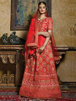 Bright And Visually Appealing Color Is Here With This Heavy Designer Lehenga Choli In Red Color. Its Blouse And Lehenga Are Fabricated On Art Silk Paired With Net Fabricated Dupatta. It Is Beautified With Heavy Jari Embroidery All Over It.