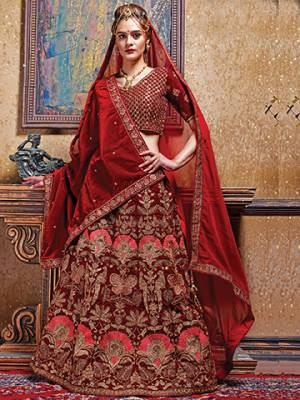 For A Royal And Elegant Look, Grab This Heavy Designer Lehenga Choli In Royal Maroon Color. This Lehenga Choli Is Fabricated On Velvet With Heavy Embroidery Paired With Georgette Fabricated Dupatta. Buy This Lehenga Choli Now.