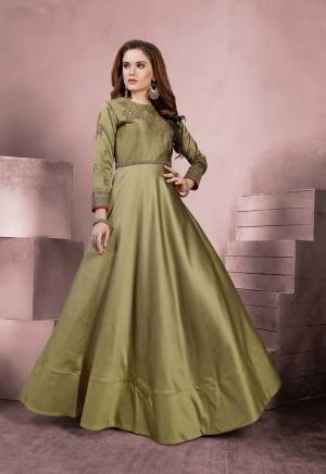 Add This Pretty Shade To Your Wardrobe With This Designer Floor Length Readymade Gown In Olive Green Color Fabricated On Tafeta Silk Beautified With Embroidery Over the Yoke And Sleeves. Buy Now.