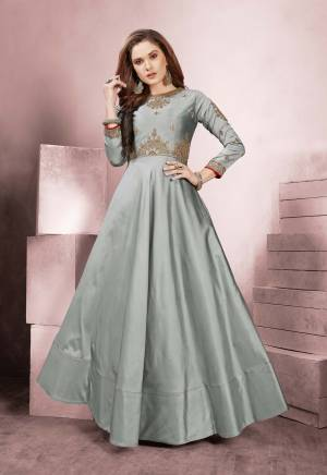 Flaunt Your Rich And Elegant Taste Wearing This Designer Readymade Gown In Grey Color On Rich Silk Based Fabric. This Gown Is Light Weight, Durable And Easy To Carry Through Out The Gala. Buy Now.