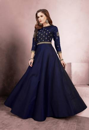 Celebrate This Festive Season Wearing This Designer Floor Length Readymade Gown In Navy Blue Color Fabricated On Tafeta Silk. It Is Beautified With Heavy Embroidery Over The Yoke And Sleeves.