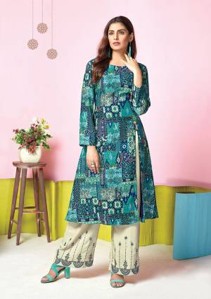 Add This Pretty Pair Of Kurti And Plazzo In Blue Colored Top Paired With White Colored Bottom. Its Top And Bottom Are Fabricated On Muslin Which Is Soft Towards Skin And Easy To Carry All Day Long.