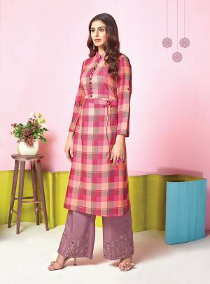 Look Pretty In This Pretty Pink Colored Kurti Paired With Contrasting Mauve Colored Plazzo. This Pretty Set Is Muslin Based Beautified With Prints And Thread Work. It Is Light In Weight And Easy To Carry All Day Long.