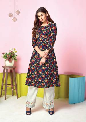 For Your Semi-Casual Wear, Grab This Pretty Set Of Kurti And Plazzo In Navy Blue Colored Kurti Paired With White Colored Plazzo. Its Top And Bottom Are Fabricated On Muslin Beautified With Prints And Thread Work.