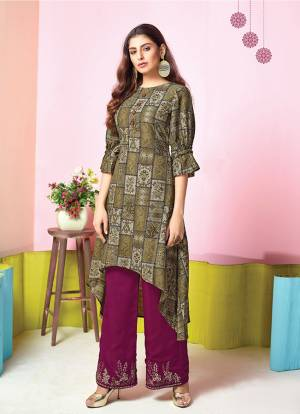 For A Simple And Elegant Festive Look, Grab This Designer Readymade Kurti And Plazzo Set In Olive Green Colored Top Paired With Contrasting Magenta Pink Colored Plazzo. This Set Is Fabricated On Muslin Beautified With Prints And Thread Work. Buy Now.