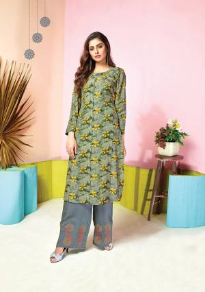 Grab This Pretty Designer Pair Of Kurti In Grey And Yellow Colored Top Paired With Grey colored Bottom. Its Top And Bottom Are Fabricated On Muslin Beautified With Prints And Thread Work. It Is Available In All Regular Sizes.