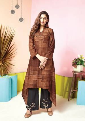 For Your Semi-Casual Wear, Grab This Pretty Set Of Kurti And Plazzo In Brown Colored Kurti Paired With Black Colored Plazzo. Its Top And Bottom Are Fabricated On Muslin Beautified With Prints And Thread Work.