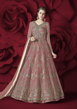 Flaunt Your Rich and Elegant Taste Wearing This Designer Floor Length Suit In Pink Colored Top Paired With Pink Colored Bottom And Dupatta. Its Top Is Fabricated On Net Paired With Silk Bottom And Net Dupatta. Its Rich and Elegant Embroidery Will Earn Your Lots Of Compliments From Onlookers.