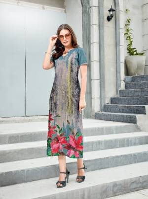 Pretty Shades Are Here With This Readymade Kurti In Blue And Grey Color Fabricated On Linen. It Has Pretty Floral Prints Over The Panel. Buy Now.