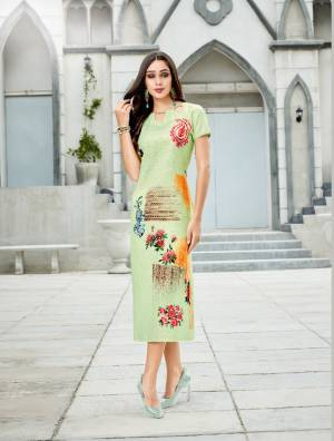 Pretty Shades Are Here With This Readymade Kurti In Light Green Color Fabricated On Linen. It Has Pretty Floral Prints Over The Panel. Buy Now.