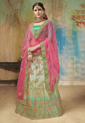 Grab This Beautiful Heavy Designer Lehenga Choli In Shades Of Green. Its Blouse Is In Green Color Paired With Light Green Colored Lehenga And Contrasting Rani Pink Colored Dupatta. This Lehenga Choli Is Fabricated On Satin Silk Paired With Net Fabricated Blouse. Buy Now.
