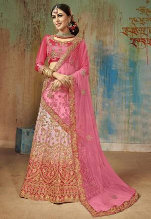 Shine Bright Wearing This Heavy Designer Lehenga Choli In Dark Pink Colored Blouse Paired With Pastel Pink Lehenga And Pink Colored Dupatta. Its Blouse And Lehenga Are Satin Silk Based Paired With Net Fabricated Dupatta. It Is Beautified With Heavy Embroidery All Over.