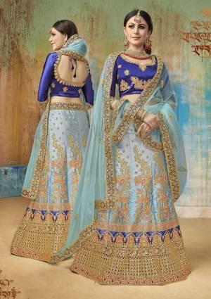 Bright And Visually Appealing Color Is Here With This Heavy Designer Lehenga Choli In Royal Blue Colored Blouse Paired With Light Blue Colored Lehenga And Dupatta. Its Blouse And Lehenga Are Fabricated On Satin Silk Paired With Net Fabricated Dupatta.