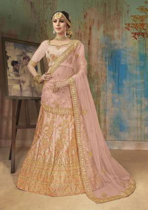 Very Pretty Shade In Pink Is Here With This Heavy Designer Lehenga Choli In Blush Pink Color. It Blouse And Lehenga Are Fabricated On Satin Silk Paired With Net Fabricated Dupatta. This Heavy Embroidered Lehenga Choli Ensures Superb Comfort All Day Long.