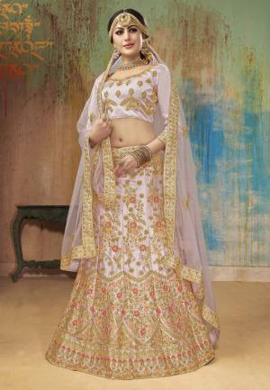 New Shade In Purple Is Here To Add Into Your Wardrobe With This Heavy Designer Lehenga Choli In Light Lavendor Color. This Heavy Embroidered Lehenga Choli Is Fabricated On Satin Silk Paired With Embroidered Net Fabricated Dupatta. Buy This Unique Piece Now.