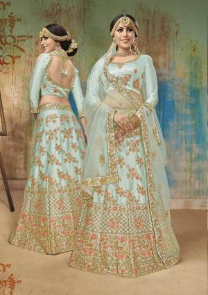 Look Pretty In This Lovely Shade Of Blue With This Heavy Designer Lehenga Choli In Aqua Blue Color. Its Blouse And Lehenga Are Fabricated On Satin Silk Paired With Net Fabricated Dupatta. Buy Now.