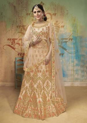 A Must Have Shade In Every Womens Wardrobe Is Here With This Heavy Designer Lehnega Choli In Peach Color. This Lehenga Choli Is Fabricated On Satin Silk Paired With Net fabricated Dupatta. All Its Fabric Are Soft Towards Skin And Easy To Carry All Day Long.