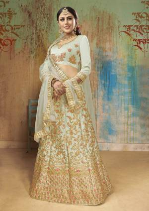Another Pretty Shade In Blue Is Here With This Heavy Designer Lehenga Choli In Baby Blue Color. This Lehenga Choli Is Satin Silk Based Paired With Net Fabricated Dupatta. Buy Now.