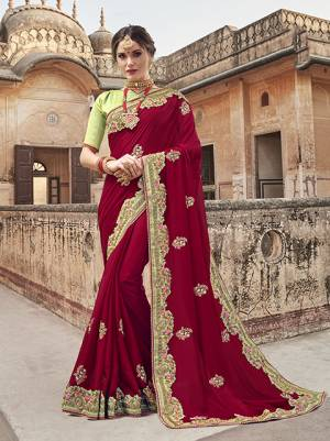 For A Royal Look, Grab This Designer Saree In Maroon Color Paired With Contrasting Light Green Colored Blouse. This Saree Is Fabricated On Georgette paired With Art Silk Fabricated Blouse. It Is Light In Weight And Ensures Superb Comfort All Day Long.