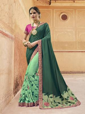 Go With The Shades Of Green With This Designer Saree In Teal Green And Sea Green color Paired With Contrasting Rani Pink Colored Blouse. This Saree Is Georgette based Paired With Art Silk Fabricated Blouse. It Has Pretty Unique Color Pallete Which Earns You Lots Of Compliments From Onlookers.
