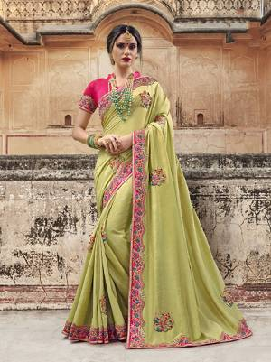 Celebrate This Festive Season Wearing This Designer Saree In Pear Green Color Paired With Contrasting Fuschia Pink Colored Blouse. This Lovely Saree Is Fabricated On Silk Georgette Paired with Art Silk Fabricated Blouse Which Gives A Rich Look To Your Personality.