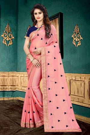 Look Pretty In This Designer Pink Colored Saree Paired With Contrasting Navy Blue Colored Blouse. This Saree Is Fabricated On Georgette Paired With Brocade Fabricated Blouse. It Is Beautified With Butti Work All Over The Saree.