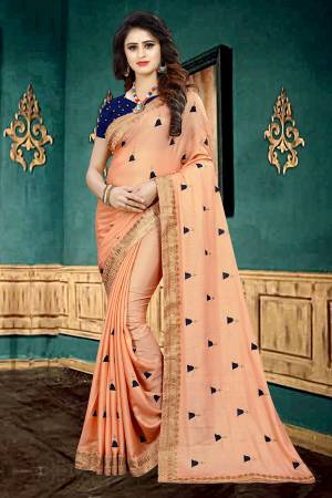 Look Pretty In This Designer Peach  Colored Saree Paired With Contrasting Navy Blue Colored Blouse. This Saree Is Fabricated On Georgette Paired With Brocade Fabricated Blouse. It Is Beautified With Butti Work All Over The Saree.