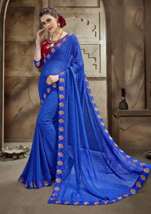 Bright And Visually Appealing Color Is Here With This Designer Saree In Royal Blue Color Paired With Contrasting Maroon Colored Blouse. This Georgette Based Saree Is Light Weight And Easy To Carry All Day Long.