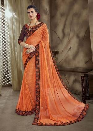 Look Beautiful Wearing This Bright Orange Colored Saree Paired With Contrasting Brown Colored Blouse. This Saree IS Georgette Based Paired With Art Silk Fabricated Blouse.