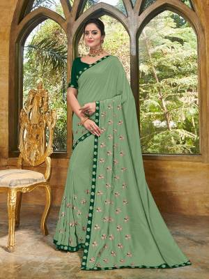 Show your elegance by wearing this gorgeous Mint green color bright georgette saree. Ideal for party, festive & social gatherings. this gorgeous saree featuring a beautiful mix of designs. Its attractive color and heavy designer embroidered saree, full saree design saree, beautiful floral design all over work over the attire & contrast hemline adds to the look. Comes along with a contrast unstitched blouse.