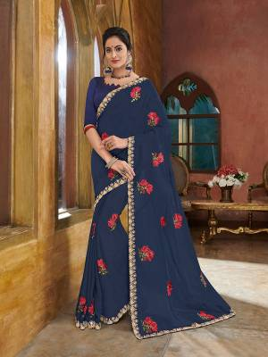 Get this amazing saree and look pretty like never before. wearing this Navy Blue color georgette saree. Ideal for party, festive & social gatherings. this gorgeous saree featuring a beautiful mix of designs. Its attractive color and heavy designer embroidered saree, full saree design saree, beautiful floral design all over work over the attire & contrast hemline adds to the look. Comes along with a contrast unstitched blouse.