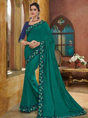 You Look elegant and stylish this festive season by draping this Teal green color silk fabrics saree. Ideal for party, festive & social gatherings. this gorgeous saree featuring a beautiful mix of designs. Its attractive color and heavy designer embroidered saree, full saree design saree, beautiful floral design all over work over the attire & contrast hemline adds to the look. Comes along with a contrast unstitched blouse.
