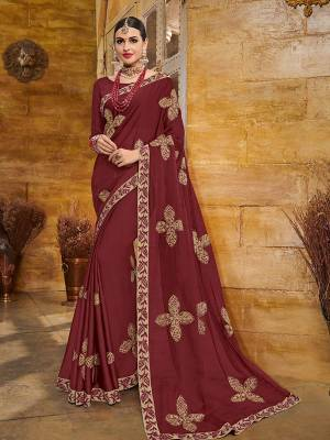 Wear this maroon color two tone bright georgette saree. Ideal for party, festive & social gatherings. this gorgeous saree featuring a beautiful mix of designs. Its attractive color and heavy designer embroidered saree, full saree design saree, beautiful floral design all over work over the attire & contrast hemline adds to the look. Comes along with a contrast unstitched blouse.