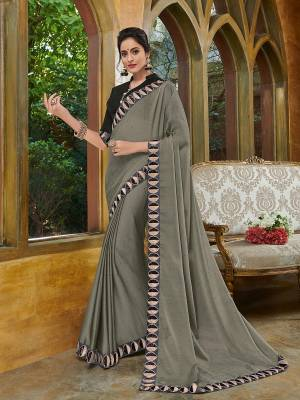 Presenting this grey color two tone chiffon pattern saree. Ideal for party, festive & social gatherings. this gorgeous saree featuring a beautiful mix of designs. Its attractive color and heavy designer embroidered saree, full saree design saree, beautiful floral design all over work over the attire & contrast hemline adds to the look. Comes along with a contrast unstitched blouse.